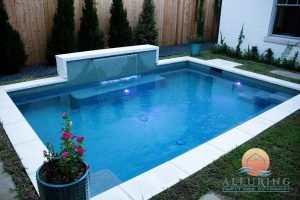 geometric pool with fountain feature